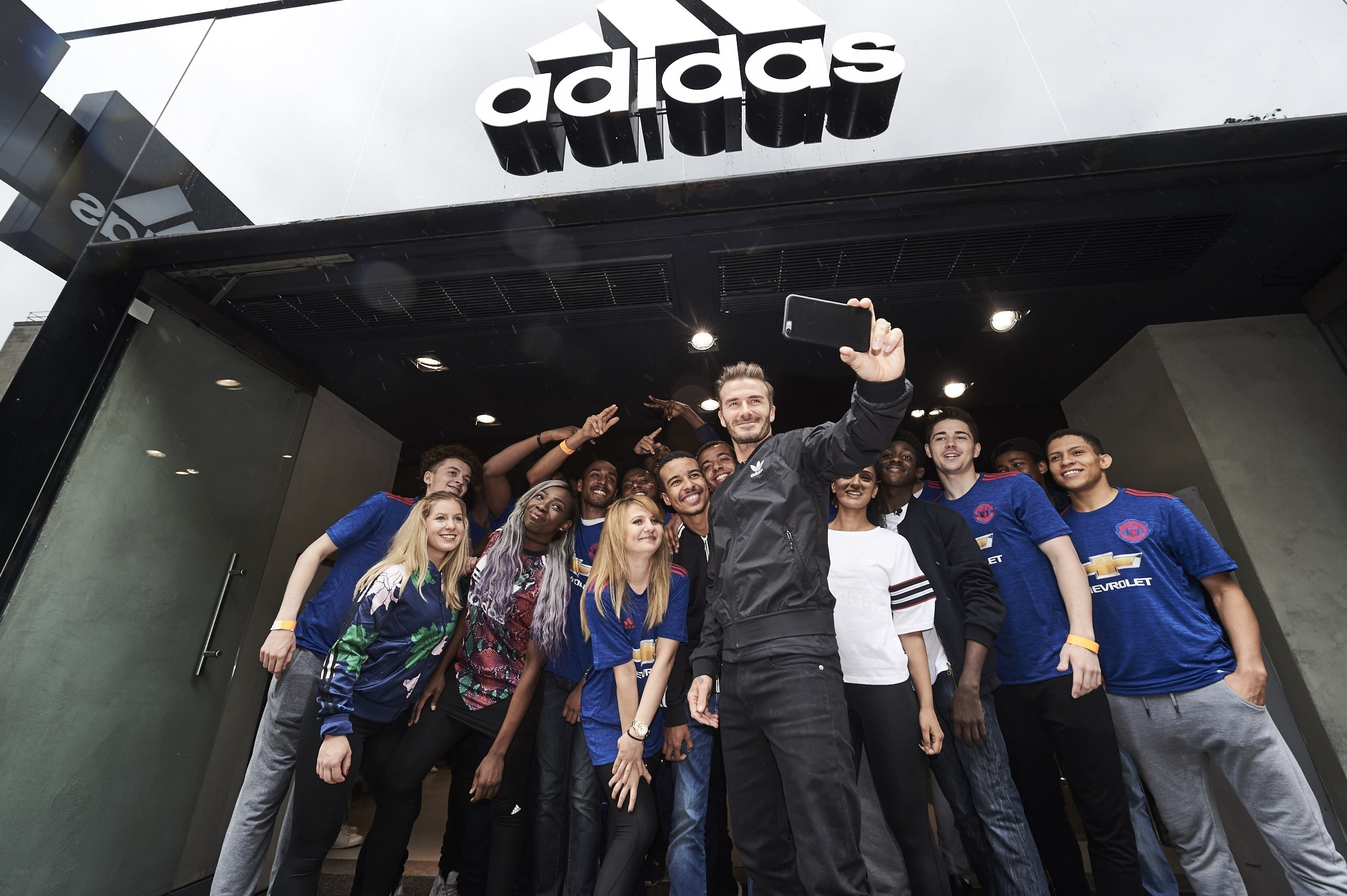 BECK IN TOWN: David Beckham meets fans outside the newly re-opened adidas store on Oxford Street. The Man Utd legend launched the club's new away shirt, available online and in-store now (Credit: Ben Duffy / adidas UK)