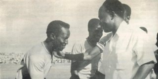 C.K Gyamfi - during his time as captain of the Black Stars - being greeted by Kwame Nkrumah before a game