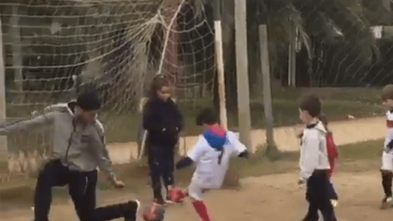 Luis Suarez plays in goal during a kid's street game in Uruguay